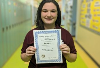 A. Gillen-Ford poses with her certificate of excellence  from the NWO District Science Fair.